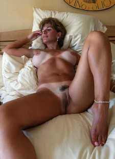 Tanned milf lady on the..