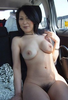 Asian milf nude in the..